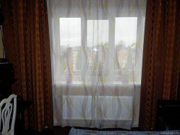 Стальной радиатор в спальне